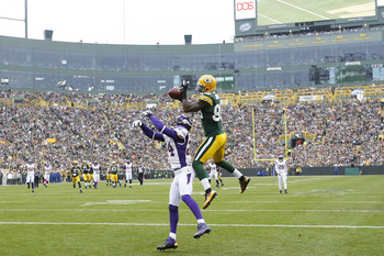 GREEN BAY, WI - DECEMBER 2: James Jones #89 of the Green Bay Packers makes a 32-yard touchdown reception against A.J. Jefferson #24 of the Minnesota Vikings during the first half of the game at Lambeau Field on December 2, 2012 in Green Bay, Wisconsin. (P