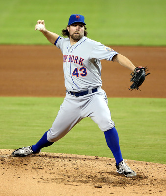 MIAMI, FL - OCTOBER 02:  Pitcher R.A. Dickey #43 of the New York Mets throws against the Miami Marlins at Marlins Park on October 2, 2012 in Miami, Florida.  (Photo by Marc Serota/Getty Images)
