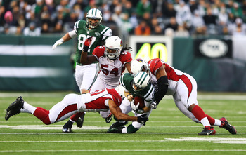 Dan Williams (right) helps bring down Mark Sanchez Sunday.