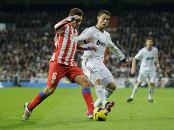 MADRID, SPAIN - DECEMBER 01:  Cristiano Ronaldo (R) of Real Madrid duels for the ball with Koke of Club Atletico de Madrid controls the ball during the la Liga match between Real Madrid CF and Club Atletico de Madrid at Estadio Santiago Bernabeu on Decemb
