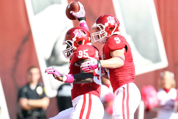 Greg Heban (No. 9) celebrating a Hoosiers touchdown.