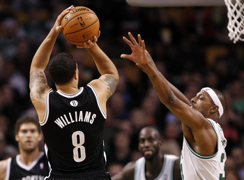 Deron Williams reigning jumpers over the Celts may be a common image this season.