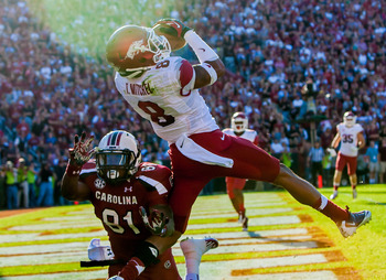 November 10, 2012; Columbia, SC, USA; Arkansas Razorbacks cornerback Tevin Mitchel (8) intercepts a pass intended for South Carolina Gamecocks tight end Rory Anderson (81) in the second half at Williams-Brice Stadium. Mandatory Credit: Jeff Blake-US PRESS