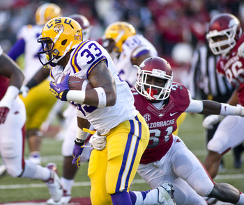 Nov 23, 2012; Fayetteville, AR, USA; Arkansas Razorbacks linebacker A.J. Turner (61) looks to tackle Louisiana State Tigers running back Jeremy Hill (33) during the second half at Donald W. Reynolds Stadium. LSU defeated Arkansas 20-13. Mandatory Credit: