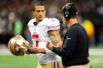 Jim Harbaugh counsels Colin Kaepernick during the Rams game.