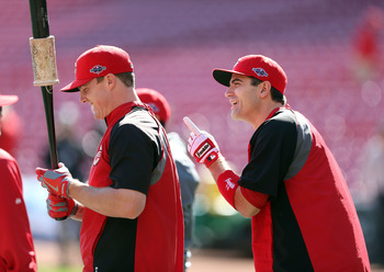 CINCINNATI, OH - OCTOBER 10:  Jay Bruce #32 and Joey Votto #19 of the Cincinnati Reds talk as they wait to bat during batting practice before Game Four of the National League Division Series against the San Francisco Giants at Great American Ball Park on