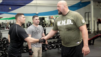 Show shakes his gym mates' hands. (Photo Credit: WWE.com)