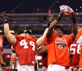 INDIANAPOLIS, IN - DECEMBER 01: Montee Ball #28 of the Wisconsin Badgers holds up the Stagg Championship Trophy with Chris Borland #44 celebrating next to him after beating the Nebraska Cornhuskers 70-31in the Big 10 Conference Championship Game at Lucas