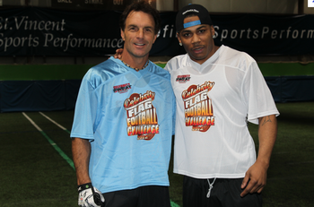 Nelly (right) pre-bandana with Douge Flutie (left). Image via Celebritysweat.com