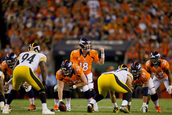 DENVER, CO - SEPTEMBER 9:  Quarterback Peyton Manning #18 of the Denver Broncos calls an audible at the line of scrimmage against the Pittsburgh Steelers at Sports Authority Field Field at Mile High on September 9, 2012 in Denver, Colorado. The Broncos de