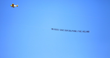 MIAMI GARDENS, FL - JANUARY 01: A banner plane with a message to owner Stephen Ross and General Manager Jeff Ireland of the Miami Dolphins fly's over Sun Life Stadium prior to taking on the New York Jets on January 1, 2012 in Miami Gardens, Florida.  (Pho
