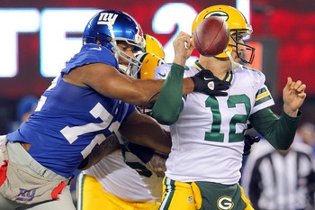 Osi Umenyiora strips Aaron Rodgers with this sack.