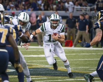 Tim Tebow with one of his 29 rushes in 2012 season.