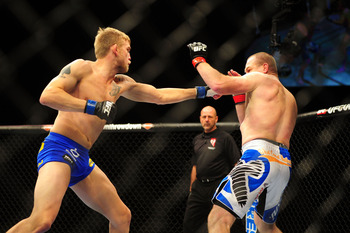 Dec 30, 2011; Las Vegas, NV, USA; UFC fighter Alexander Gustafsson (left) fights against Vladimir Matyushenko during a light featherweight bout at UFC 141 at the MGM Grand Garden event center. Mandatory Credit: Mark J. Rebilas-USA TODAY Sports