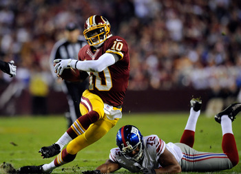 RG3 puts a little shake, rattle and roll after evading NY Giants DE Osi Umenyiora.