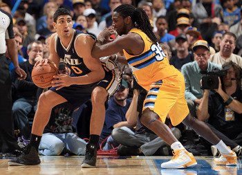 DENVER, CO - NOVEMBER 09:  Enes Kanter #0 of the Utah Jazz controls the ball against the defense of Kenneth Faried #35 of the Denver Nuggets at the Pepsi Center on November 9, 2012 in Denver, Colorado. The Nuggets defeated the Jazz 104-84. NOTE TO USER: U