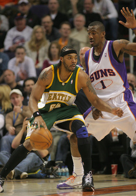PHOENIX - FEBRUARY 8:  Chris Wilcox #54 of the Seattle SuperSonics posts against Amare' Stoudemire #1 of the Phoenix Suns on February 8, 2008 at US Airways Center in Phoenix, Arizona. NOTE TO USER: User expressly acknowledges and agrees that, by downloadi