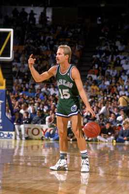 LOS ANGELES - 1989:  Brad Davis #15 of the Dallas Mavericks sets up a play during the NBA game against the Los Angeles Lakers at the Great Western Forum in Los Angeles, California in 1989. NOTE TO USER: User expressly acknowledges and agrees that, by down