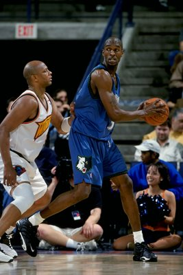 15 Feb 1999:  Joe Smith #32 of the Minnesota Timberwolves looks to pass the ball while being covered by Terry Cummings #35 during the game against the Golden State Warriors at the Oakland Arena in Oakland, California. The Warriors defeated the Timberwolve