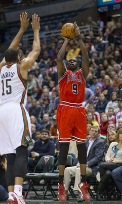 Nov 24, 2012; Milwaukee, WI, USA;  Chicago Bulls forward Luol Deng (9) shoots during the first quarter against the Milwaukee Bucks at the BMO Harris Bradley Center.  Mandatory Credit: Jeff Hanisch-USA TODAY Sports