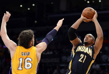 Los Angeles Lakers forward Pau Gasol (left) fails to defend Indiana Pacers forward David West