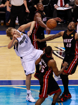 DALLAS, TX - JUNE 09:  Dirk Nowitzki #41 of the Dallas Mavericks loses the ball as he drives against Mario Chalmers #15, Dwyae Wade #3 and Udonis Haslem #40 of the Miami Heat in the second half of Game Five of the 2011 NBA Finals at American Airlines Cent