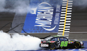 BROOKLYN, MI - JUNE 17:  Dale Earnhardt Jr., driver of the #88 Diet Mountain Dew/TheDarkKnightRises/National Guard/ Chevrolet, celebrates winning the NASCAR Sprint Cup Series Quicken Loans 400 with a burnout at Michigan International Speedway on June 17,
