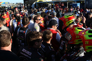 AVONDALE, AZ - NOVEMBER 11:  Police break up fights in the garage area after an on-track incident with Clint Bowyer (not pictured), driver of the #15 5-hour Energy Toyota, and Jeff Gordon (not pictured), driver of the #24 DuPont Chevrolet, during the NASC
