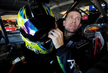 FORT WORTH, TX - NOVEMBER 02:  Carl Edwards holds his helmet while sitting in the #99 Aflac Ford before the start of practice for the NASCAR Sprint Cup Series AAA Texas 500 at Texas Motor Speedway on November 2, 2012 in Fort Worth, Texas.  (Photo by Jared