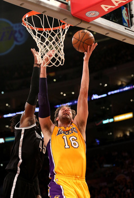 LOS ANGELES, CA - NOVEMBER 20:  Pau Gasol #16 of the Los Angeles Lakers shoots over Gerald Wallace #45 of the Brooklyn Nets at Staples Center on November 20, 2012 in Los Angeles, California.  NOTE TO USER: User expressly acknowledges and agrees that, by d