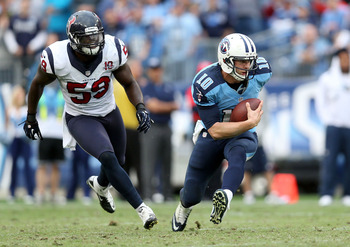 NASHVILLE, TN - DECEMBER 02:  Jake Locker #10 of the Tennessee Titans runs with the ball during the NFL game against the Houston Texans at LP Field on December 2, 2012 in Nashville, Tennessee.  (Photo by Andy Lyons/Getty Images)