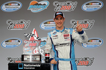 AVONDALE, AZ - NOVEMBER 10:  Joey Logano, driver of the #18 GameStop/Epic Mickey2 Toyota, poses in Victory Lane after winning the NASCAR Nationwide Series Great Clips 200 at Phoenix International Raceway on November 10, 2012 in Avondale, Arizona.  (Photo