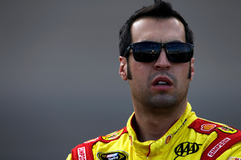 AVONDALE, AZ - NOVEMBER 09:  Sam Hornish Jr., driver of the #22 Shell/Pennzoil Dodge, stands on the grid during qualifying for the NASCAR Sprint Cup Series AdvoCare 500 at Phoenix International Raceway on November 9, 2012 in Avondale, Arizona.  (Photo by