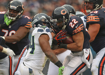 CHICAGO, IL - DECEMBER 02: Matt Forte #22 of the Chicago Bears is hit by Bobby Wagner #54 of the Seattle Seahawks at Soldier Field on December 2, 2012 in Chicago, Illinois. The Seahawks defeated the Bears 23-17 in overtime. (Photo by Jonathan Daniel/Getty
