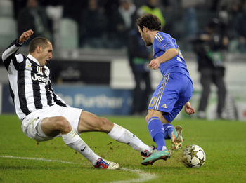 TURIN, ITALY - NOVEMBER 20:  Giorgio Chiellini of Juventus FC (L) and Juan Mata of Chelsea FC (R) compete for the ball during the UEFA Champions League Group E match between Juventus and Chelsea FC at Juventus Arena on November 20, 2012 in Turin, Italy.
