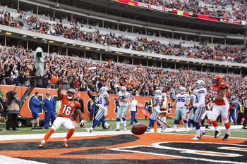 Andrew Hawkins celebrates as he scores the first touchdown of the game for Cincinnati in the first quarter.