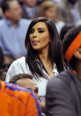 Dec 6, 2012; Miami FL, USA; Television personality Kim Kardashian looks over the New York Knicks bench during the second half of game action against the Miami Heat at American Airlines Arena. Knicks won 112-92. Mandatory Credit: Steve Mitchell-USA TODAY S