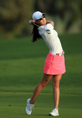 DUBAI, UNITED ARAB EMIRATES - DECEMBER 05:  Michelle Wie of the USA plays her second shot at the par54, 18th hole during the first round of the 2012 Omega Dubai Ladies Masters on the Majilis Course at the Emirates Golf Club on December 5, 2012 in Dubai, U
