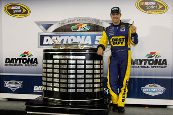 DAYTONA BEACH, FL - FEBRUARY 27:  Matt Kenseth, driver of the #17 Best Buy Ford, poses with the Harley J. Earl Trophy in Victory Lane after winning the NASCAR Sprint Cup Series Daytona 500 at Daytona International Speedway on February 27, 2012 in Daytona 