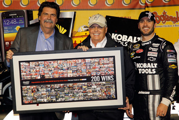 Rick Hendrick (center) and friends following his 200th career Sprint Cup win as a team owner.