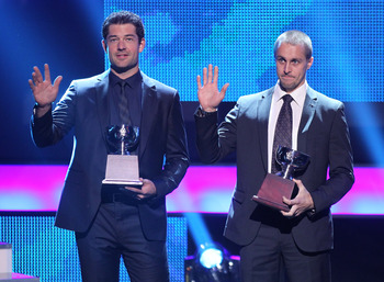 Brian Elliott (left) and Jaroslav Halak accepting the William M. Jennings Trophy.