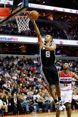 WASHINGTON, DC - NOVEMBER 26:  Tony Parker #9 of the San Antonio Spurs puts up a shot in front of A.J. Price #12 of the Washington Wizards during the second half of the Spurs 118-92 win at Verizon Center on November 26, 2012 in Washington, DC. NOTE TO USE