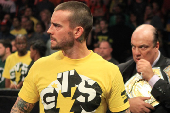 At TLC, it's more of this: WWE champion CM Punk just watching. (Photo Credit: WWE.com)