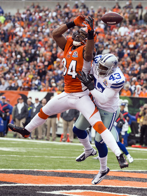 December 9, 2012; Cincinnati, OH, USA; Dallas Cowboys free safety Gerald Sensabaugh (43) knocks the ball loose as Cincinnati Bengals tight end Jermaine Gresham (84) tries to hang on at Paul Brown Stadium. Dallas won the game 20-19. Mandatory Credit: Greg 