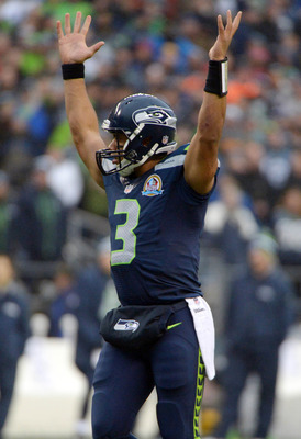 Russell Wilson celebrates the Seahawks' 58-0 win over the Arizona Cardinals.