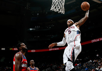 Josh Smith soars for the dunk against Washington.