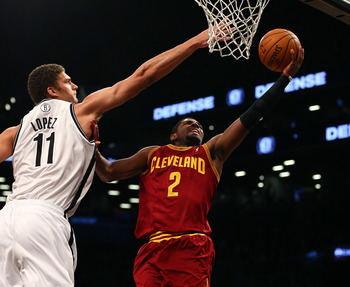 Kyrie Irving goes up for a layup against Brooklyn.