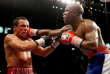 Juan Manuel Marquez receiving a beating from Floyd Mayweather Jr.
