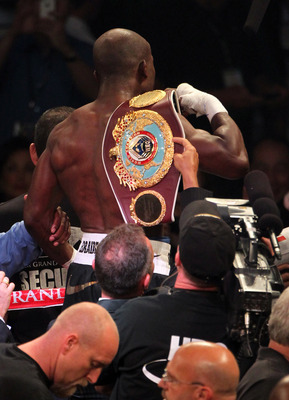 "Timothy Bradley wields the championship he's recently ""won"" from Manny Pacquiao."