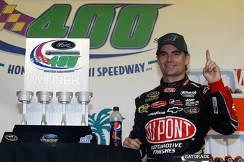 HOMESTEAD, FL - NOVEMBER 18:  Jeff Gordon, driver of the #24 DuPont 20 Years Celebratory Chevrolet, celebrates in Victory Lane after winning the NASCAR Sprint Cup Series Ford EcoBoost 400 at Homestead-Miami Speedway on November 18, 2012 in Homestead, Flor